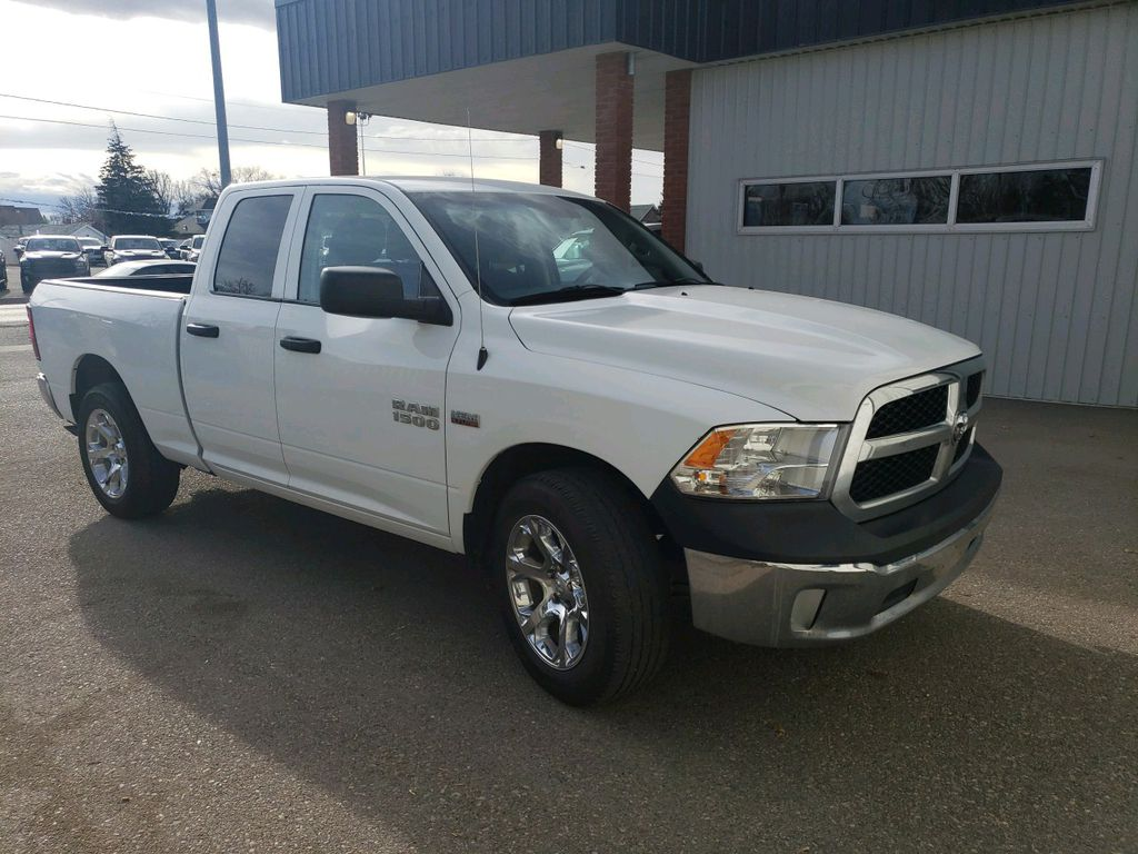 White 2014 Ram 1500 Left Front Rim and Tire Photo in Fort Macleod AB