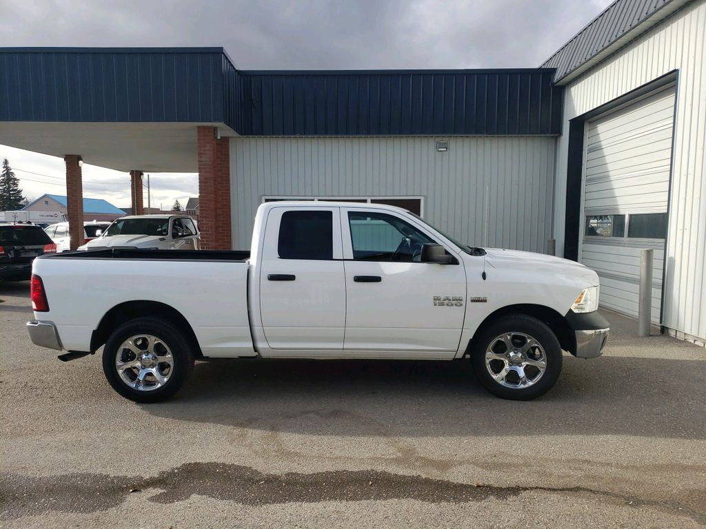 White 2014 Ram 1500 Left Front Interior Photo in Fort Macleod AB