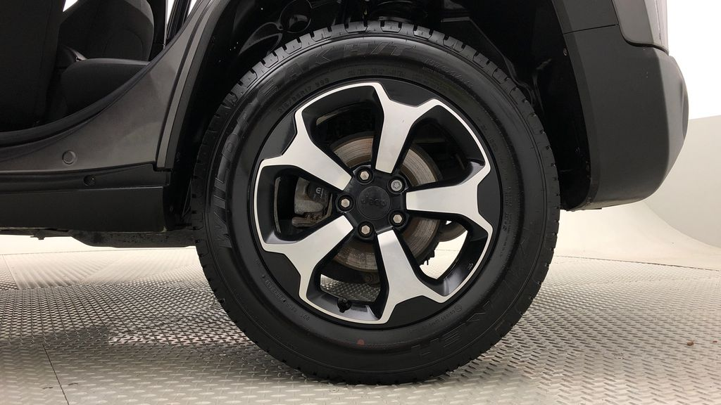 Gray[Granite Crystal Metallic] 2019 Jeep Renegade Trailhawk 4WD - My Sky Open Air Roof System Left Rear Rim and Tire Photo in Winnipeg MB