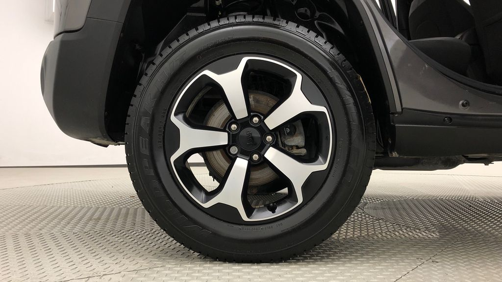 Gray[Granite Crystal Metallic] 2019 Jeep Renegade Trailhawk 4WD - My Sky Open Air Roof System Right Rear Rim and Tire Photo in Winnipeg MB