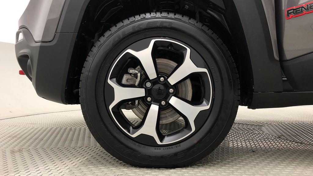 Gray[Granite Crystal Metallic] 2019 Jeep Renegade Trailhawk 4WD - My Sky Open Air Roof System Left Front Rim and Tire Photo in Winnipeg MB