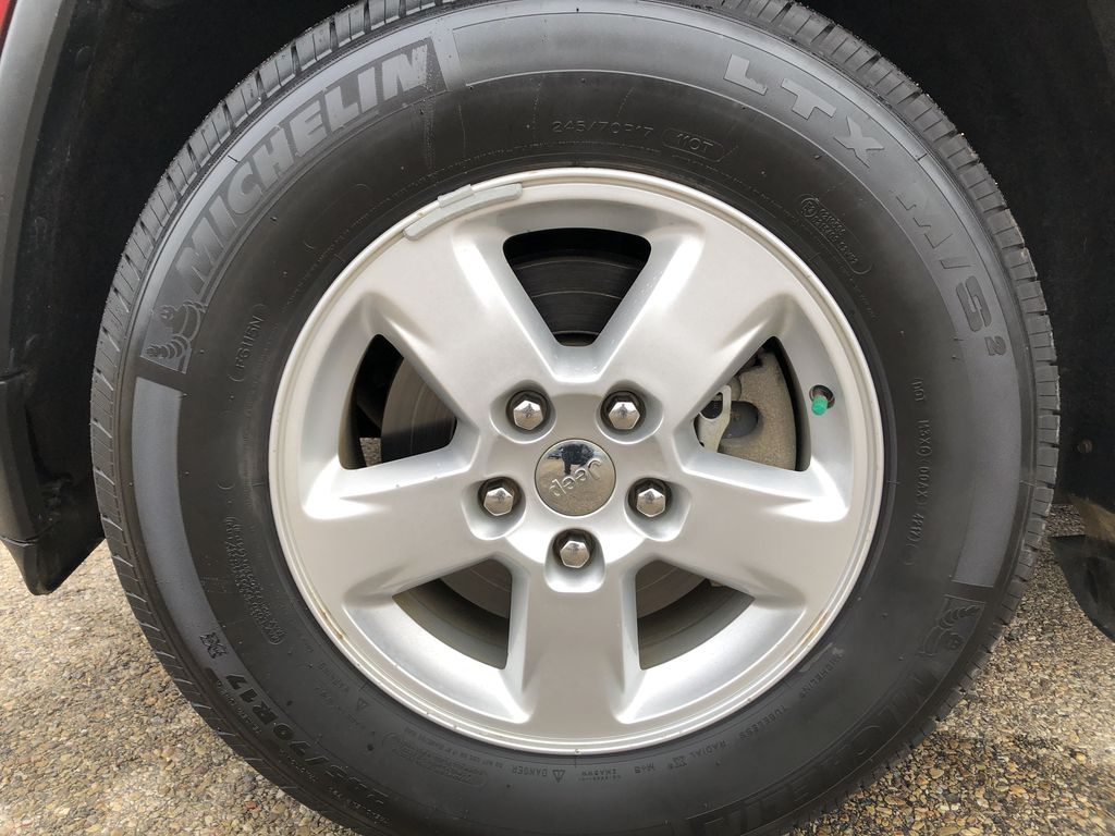 Black[Brilliant Black Crystal Pearl] 2013 Jeep Grand Cherokee Left Front Rim and Tire Photo in Edmonton AB