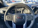 Black[Onyx Black] 2021 GMC Sierra 1500 Elevation Steering Wheel and Dash Photo in Calgary AB