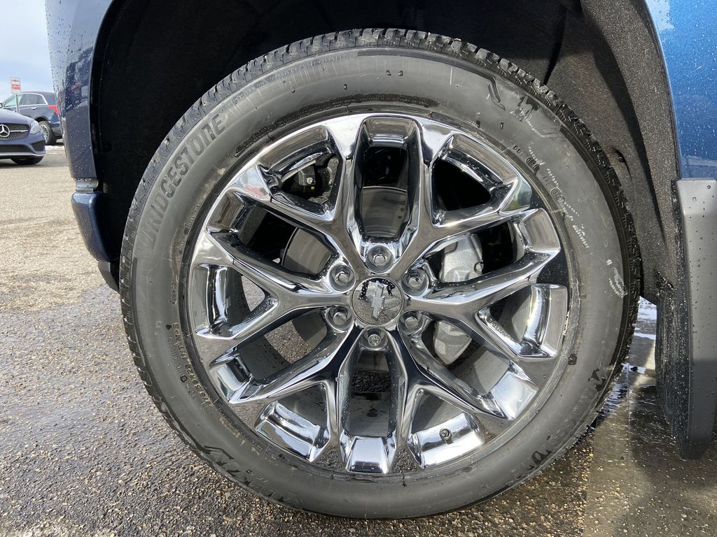 Blue[Northsky Blue Metallic] 2021 Chevrolet Silverado 1500 High Country Left Front Rim and Tire Photo in Calgary AB