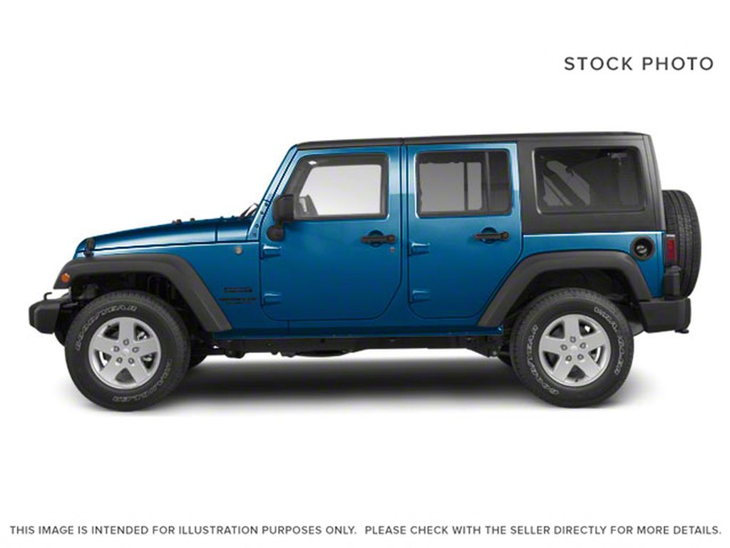 Blue[Deep Water Blue Pearl] 2010 Jeep Wrangler Unlimited Left Side Photo in Fort Macleod AB