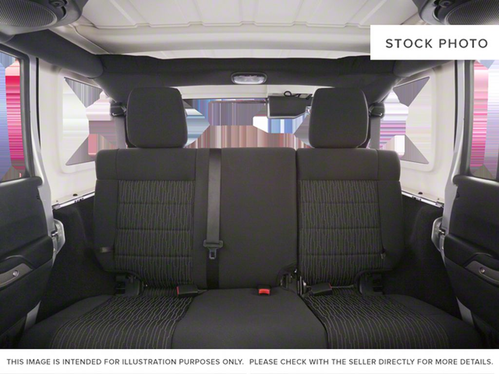 Blue[Deep Water Blue Pearl] 2010 Jeep Wrangler Unlimited Left Side Rear Seat  Photo in Fort Macleod AB