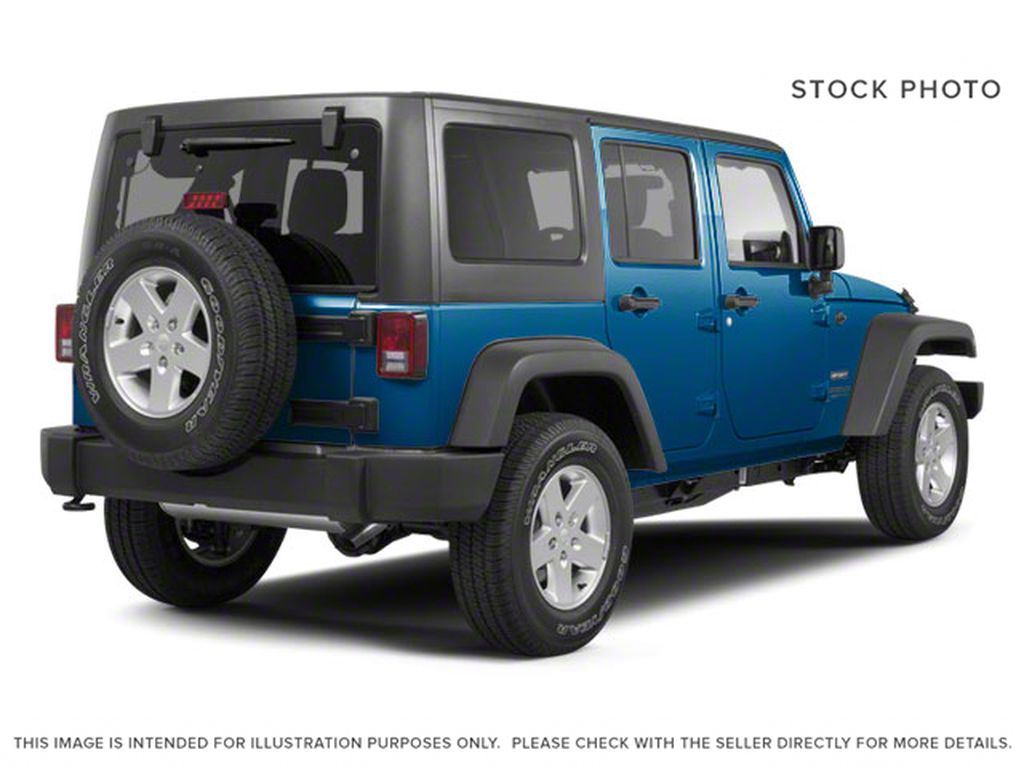 Blue[Deep Water Blue Pearl] 2010 Jeep Wrangler Unlimited Right Rear Corner Photo in Fort Macleod AB
