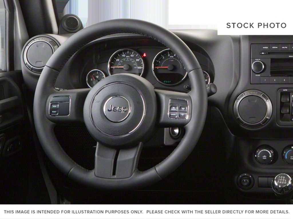 Blue[Deep Water Blue Pearl] 2010 Jeep Wrangler Unlimited Steering Wheel and Dash Photo in Fort Macleod AB