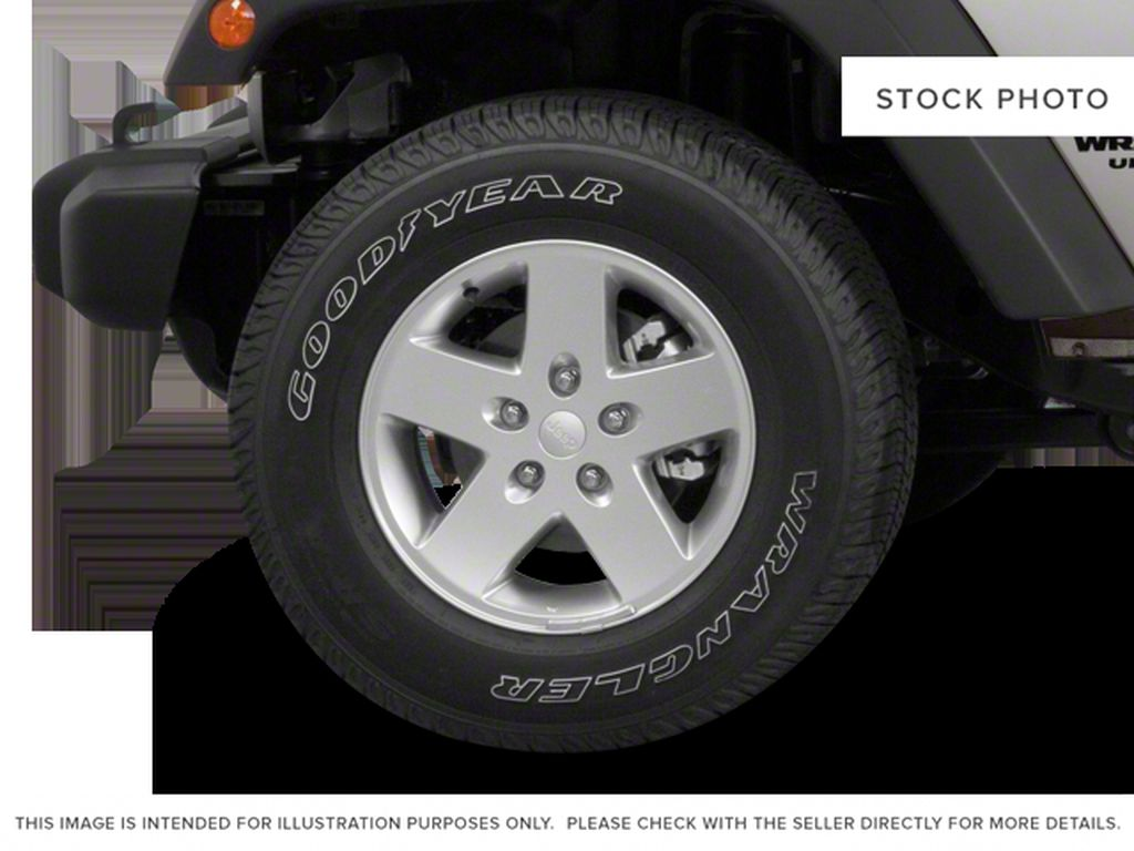 Blue[Deep Water Blue Pearl] 2010 Jeep Wrangler Unlimited Left Front Rim and Tire Photo in Fort Macleod AB