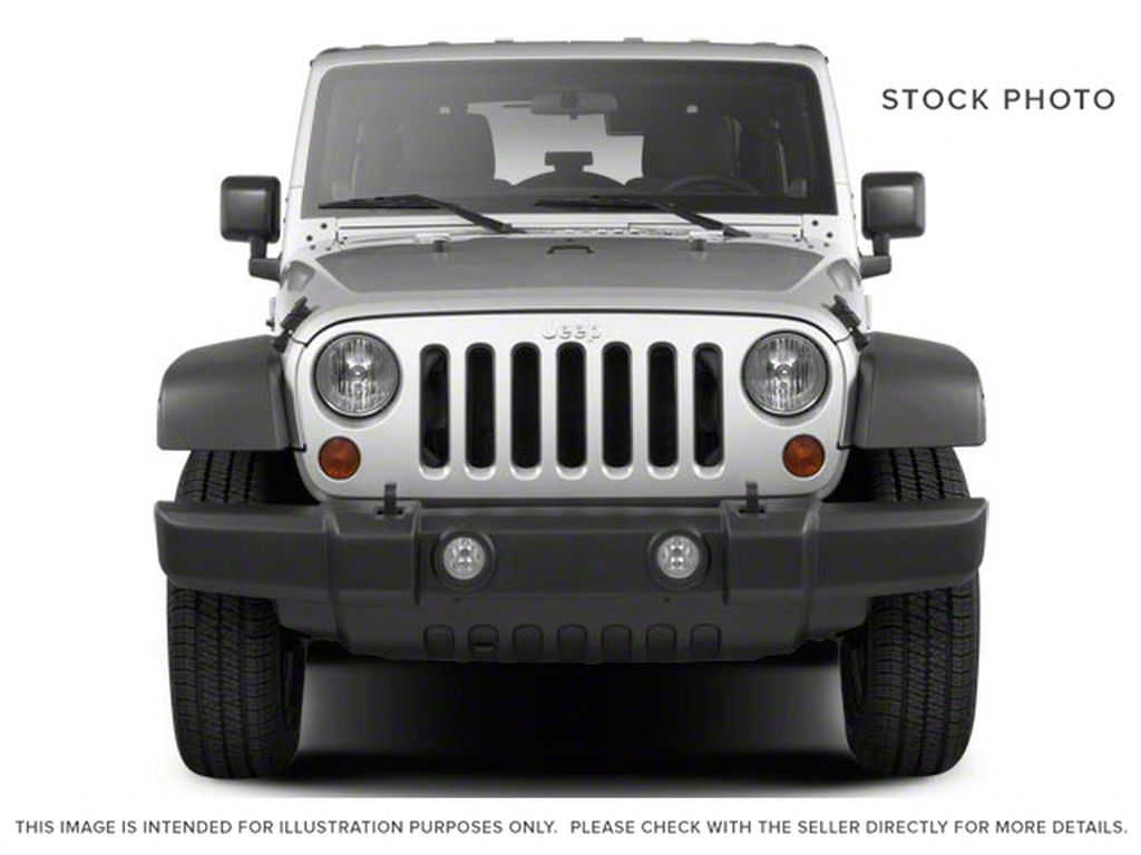 Blue[Deep Water Blue Pearl] 2010 Jeep Wrangler Unlimited Front Vehicle Photo in Fort Macleod AB