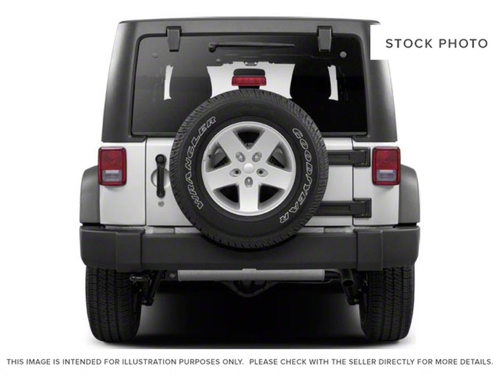 Blue[Deep Water Blue Pearl] 2010 Jeep Wrangler Unlimited Rear of Vehicle Photo in Fort Macleod AB