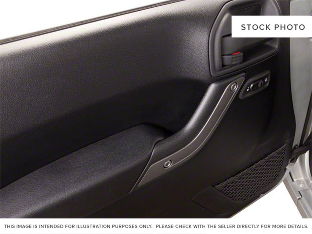 Blue[Deep Water Blue Pearl] 2010 Jeep Wrangler Unlimited Left Front Interior Door Panel Photo in Fort Macleod AB