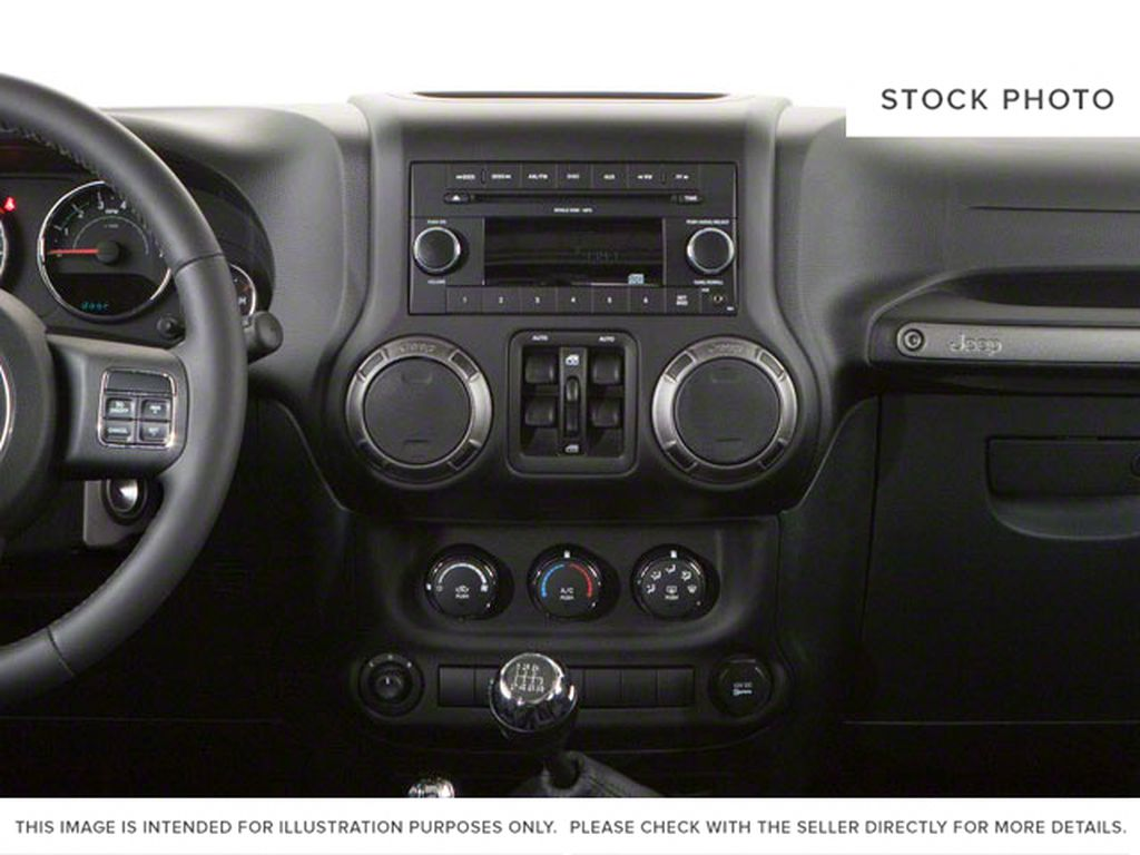 Blue[Deep Water Blue Pearl] 2010 Jeep Wrangler Unlimited Central Dash Options Photo in Fort Macleod AB