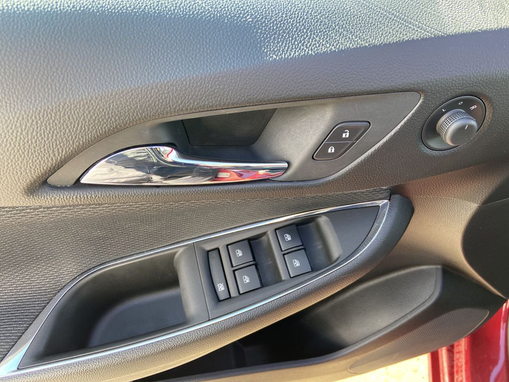 Red[Cajun Red Tintcoat] 2019 Chevrolet Cruze LT  Driver's Side Door Controls Photo in Calgary AB