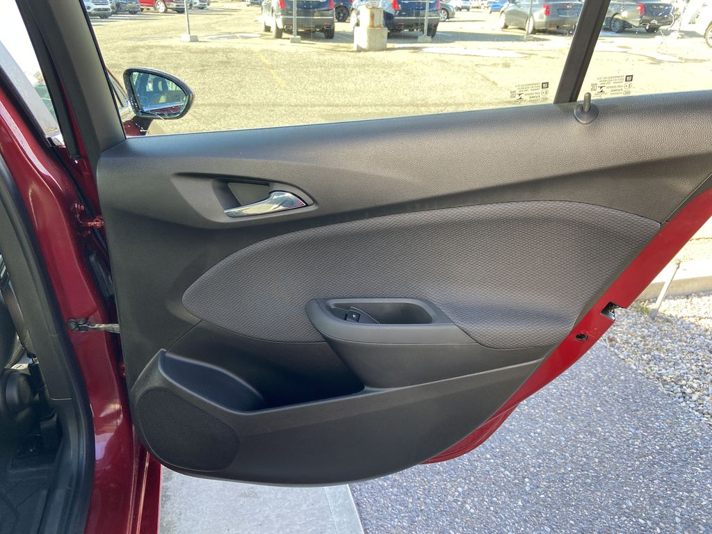 Red[Cajun Red Tintcoat] 2019 Chevrolet Cruze LT Right Rear Interior Door Panel Photo in Calgary AB