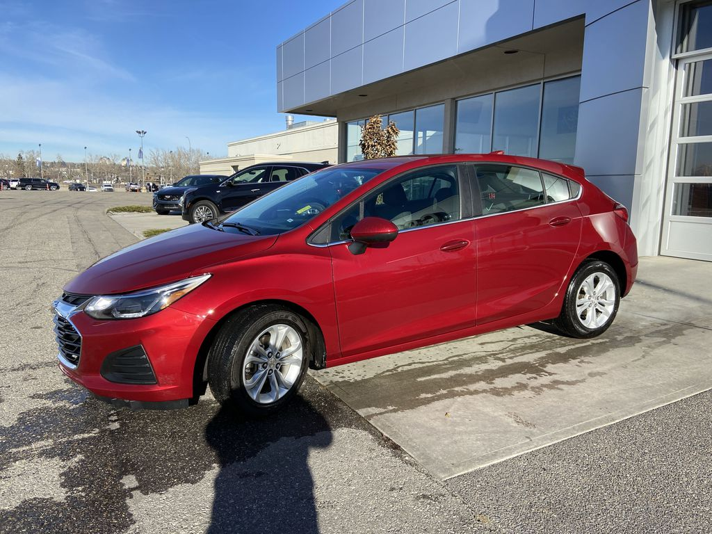 Red[Cajun Red Tintcoat] 2019 Chevrolet Cruze LT Left Front Corner Photo in Calgary AB