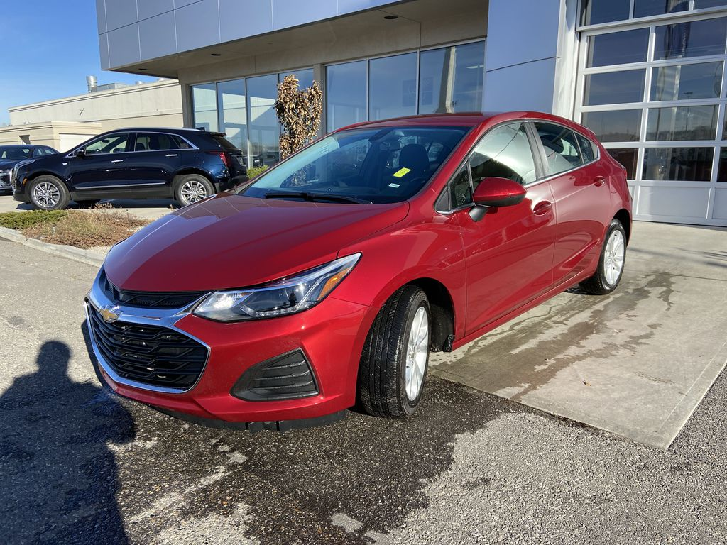 Red[Cajun Red Tintcoat] 2019 Chevrolet Cruze LT Left Front Head Light / Bumper and Grill in Calgary AB