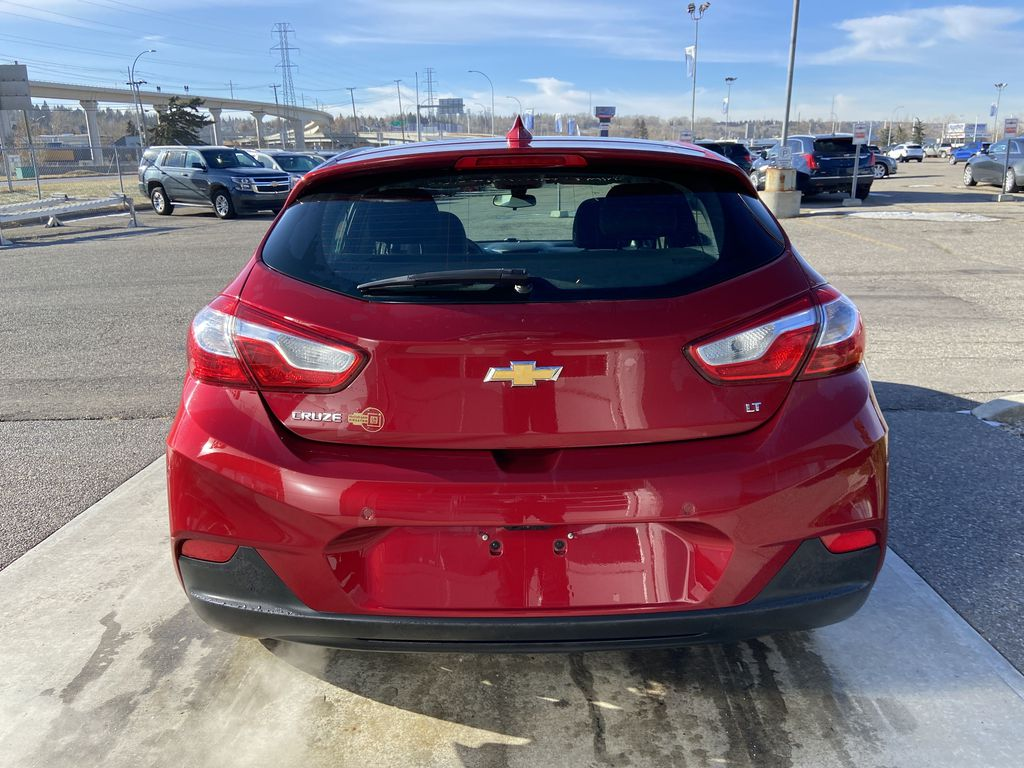 Red[Cajun Red Tintcoat] 2019 Chevrolet Cruze LT Rear of Vehicle Photo in Calgary AB