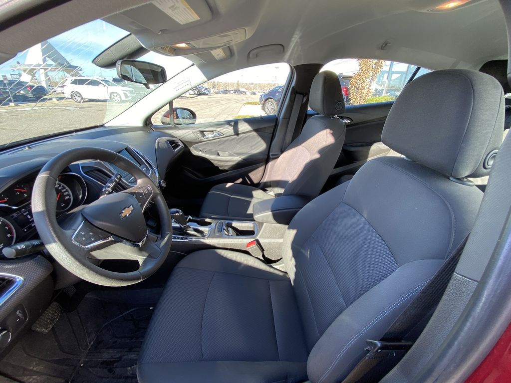 Red[Cajun Red Tintcoat] 2019 Chevrolet Cruze LT Left Front Interior Photo in Calgary AB