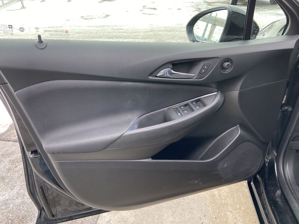 Black[Black] 2019 Chevrolet Cruze LT True North Left Front Interior Door Panel Photo in Calgary AB