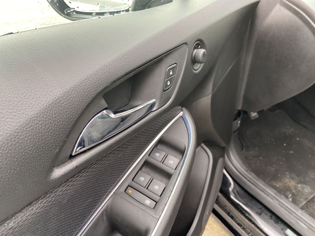 Black[Black] 2019 Chevrolet Cruze LT True North  Driver's Side Door Controls Photo in Calgary AB