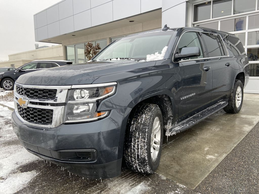Gray[Shadow Grey Metallic] 2019 Chevrolet Suburban Left Front Head Light / Bumper and Grill in Calgary AB