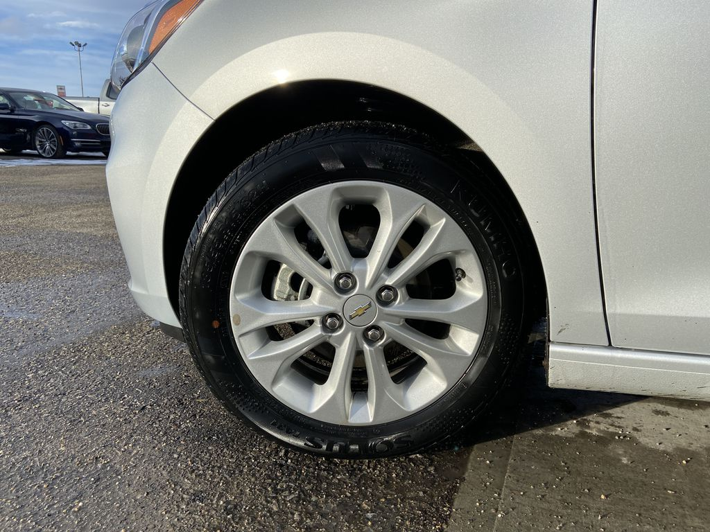 Silver[Silver Ice Metallic] 2019 Chevrolet Spark 1LT Left Front Rim and Tire Photo in Calgary AB