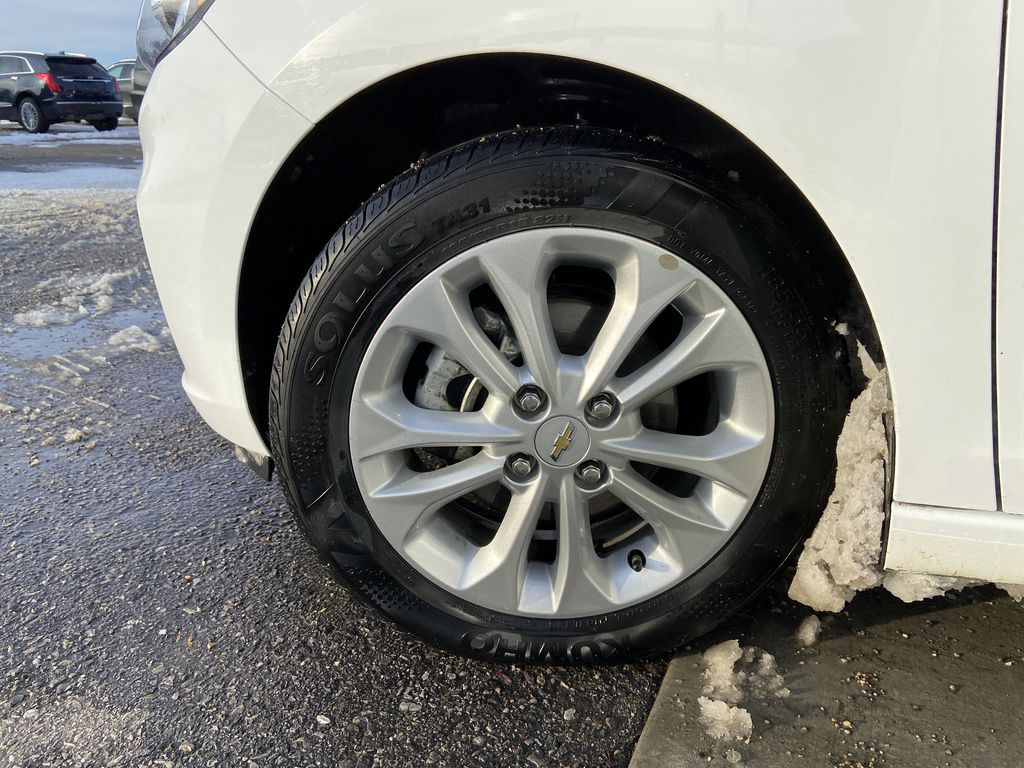 White[Summit White] 2019 Chevrolet Spark Left Front Rim and Tire Photo in Calgary AB
