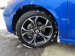 Blue[Kinetic Blue Metallic] 2019 Chevrolet Cruze LT Left Front Rim and Tire Photo in Calgary AB