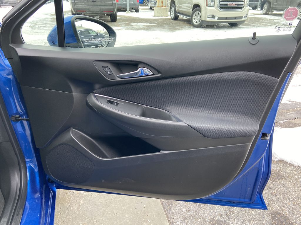 Blue[Kinetic Blue Metallic] 2019 Chevrolet Cruze LT True North Right Front Interior Door Panel Photo in Calgary AB