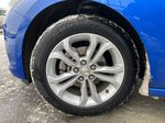 Blue[Kinetic Blue Metallic] 2019 Chevrolet Cruze LT True North Left Front Rim and Tire Photo in Calgary AB