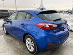 Blue[Kinetic Blue Metallic] 2019 Chevrolet Cruze LT True North Left Rear Corner Photo in Calgary AB
