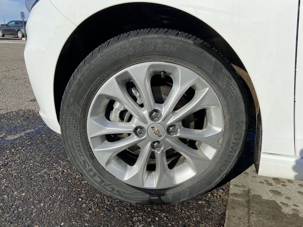 White[Summit White] 2019 Chevrolet Spark 1LT Left Front Rim and Tire Photo in Calgary AB