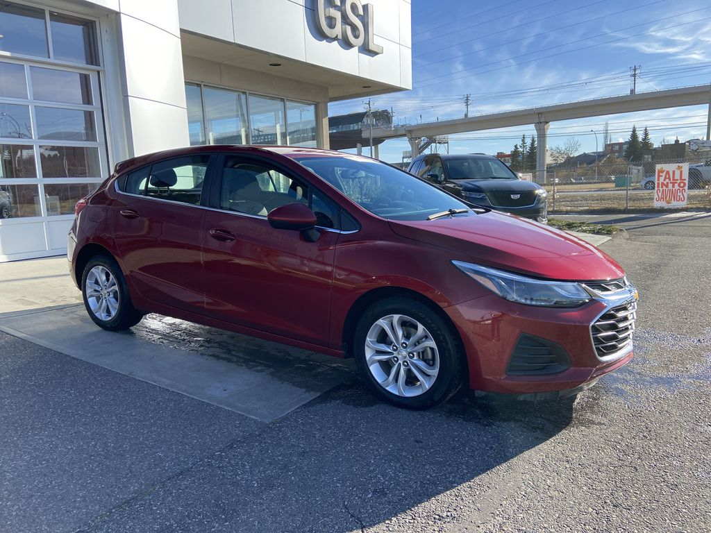 Red[Cajun Red Tintcoat] 2019 Chevrolet Cruze LT True North Right Front Corner Photo in Calgary AB