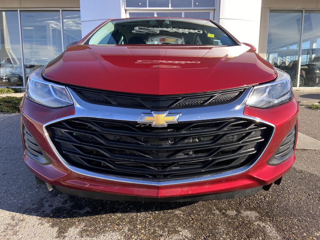 Red[Cajun Red Tintcoat] 2019 Chevrolet Cruze LT True North Front Vehicle Photo in Calgary AB