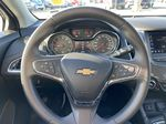 Red[Cajun Red Tintcoat] 2019 Chevrolet Cruze LT True North Steering Wheel and Dash Photo in Calgary AB