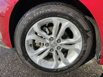 Red[Cajun Red Tintcoat] 2019 Chevrolet Cruze LT True North Left Front Rim and Tire Photo in Calgary AB