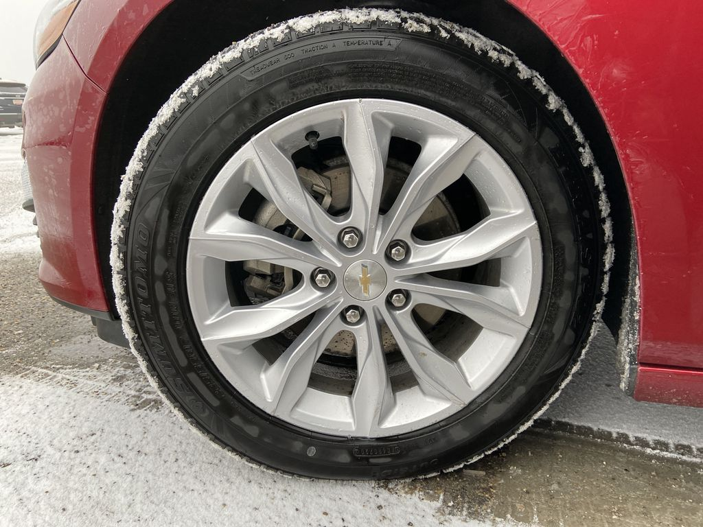 Red[Cajun Red Tintcoat] 2019 Chevrolet Malibu LT Left Front Rim and Tire Photo in Calgary AB