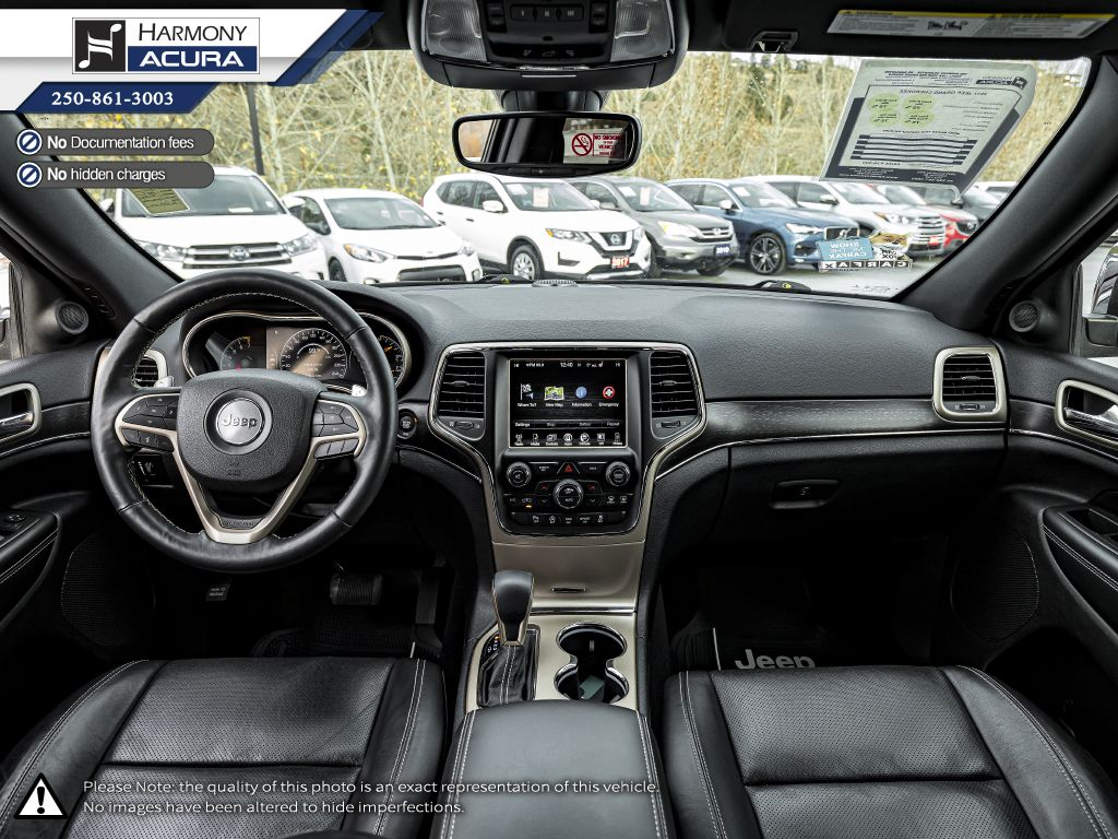 Red - Velvet Red Pearl 2017 Jeep Grand Cherokee Left Front Seat Photo in Kelowna BC