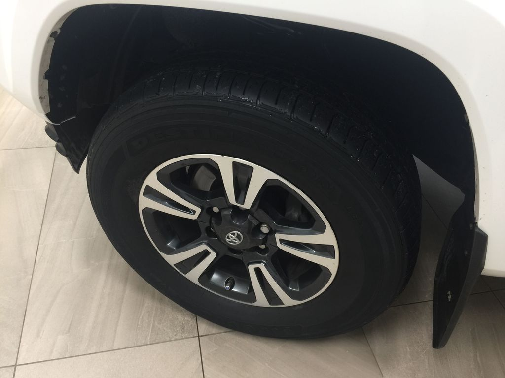 White[Alpine White] 2018 Toyota Tacoma TRD Sport 4x4 Left Front Rim and Tire Photo in Sherwood Park AB