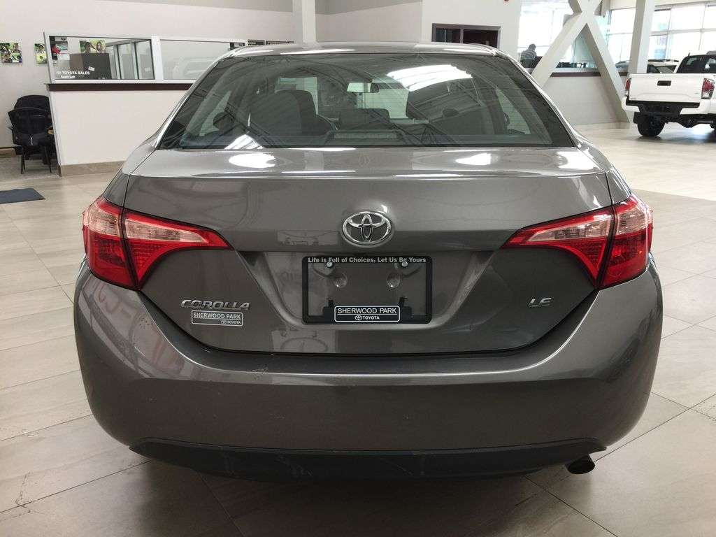BROWN 2018 Toyota Corolla LE Upgrade Rear of Vehicle Photo in Sherwood Park AB