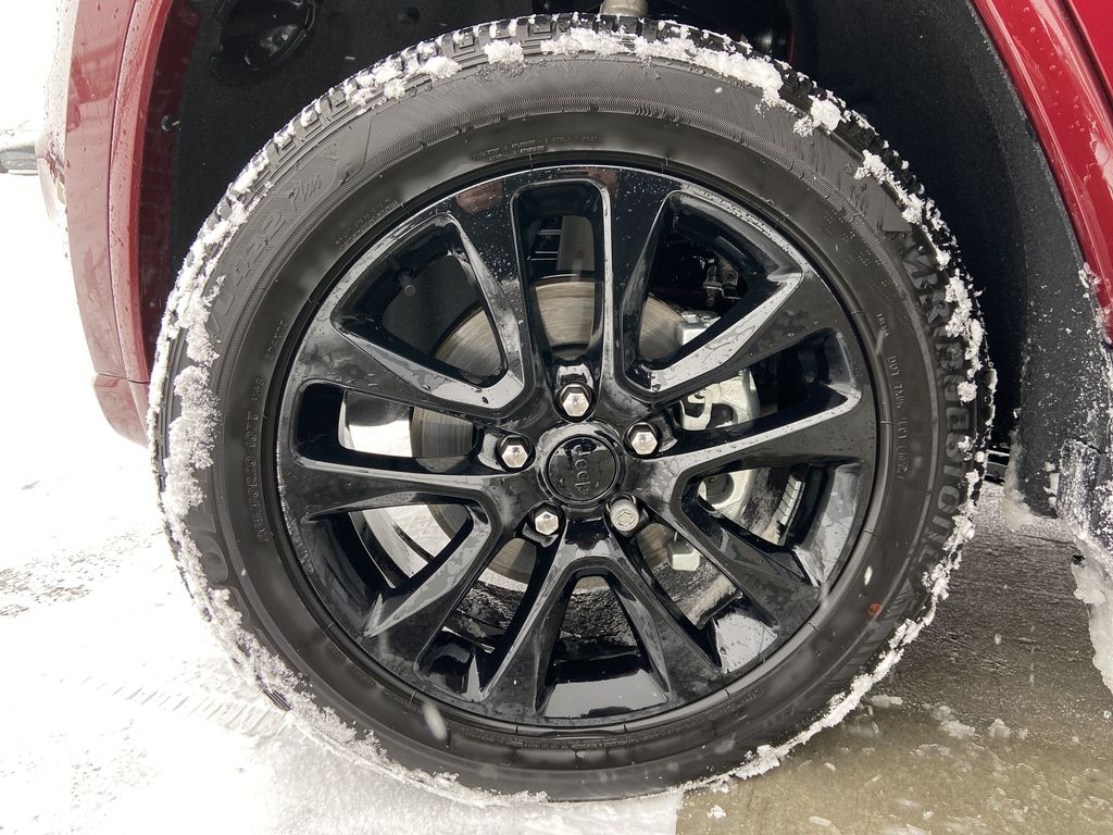 Red[Velvet Red Pearl] 2020 Jeep Grand Cherokee Altitude Left Front Rim and Tire Photo in Calgary AB