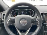 Red[Velvet Red Pearl] 2020 Jeep Grand Cherokee Altitude Steering Wheel and Dash Photo in Calgary AB