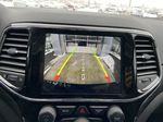 Red[Velvet Red Pearl] 2020 Jeep Grand Cherokee Altitude Backup Camera Closeup Photo in Calgary AB