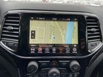 Red[Velvet Red Pearl] 2020 Jeep Grand Cherokee Altitude Navigation Screen Closeup Photo in Calgary AB