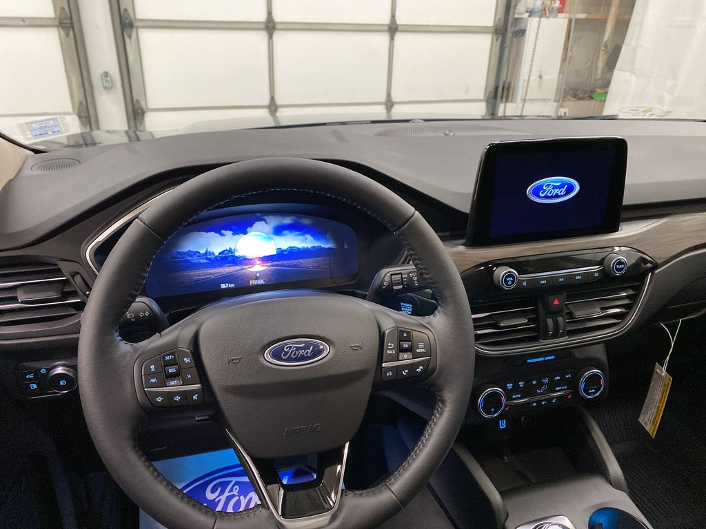 Blue[Blue Metallic] 2020 Ford Escape Steering Wheel and Dash Photo in Dartmouth NS