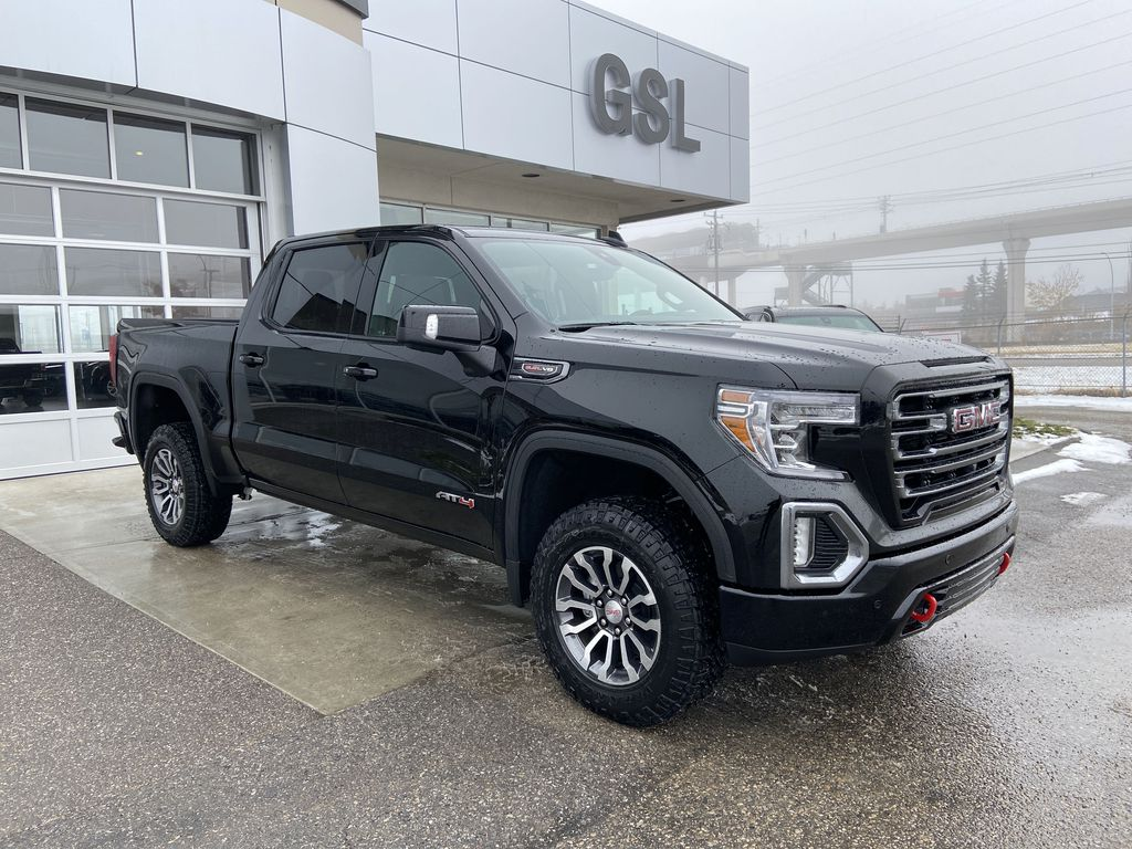 Black[Onyx Black] 2021 GMC Sierra 1500 AT4 Right Front Corner Photo in Calgary AB