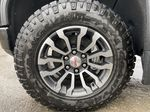 Black[Onyx Black] 2021 GMC Sierra 1500 AT4 Left Front Rim and Tire Photo in Calgary AB