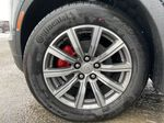 Gray[Shadow Metallic] 2021 Cadillac XT4 Sport Left Front Rim and Tire Photo in Calgary AB