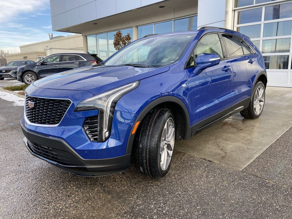 Blue[Wave Metallic] 2021 Cadillac XT4 Sport Left Front Head Light / Bumper and Grill in Calgary AB